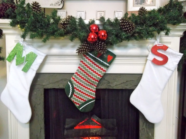 stocking, initials, mantel, garland, decor, home, holiday, Christmas, candle, pinecones, ornaments