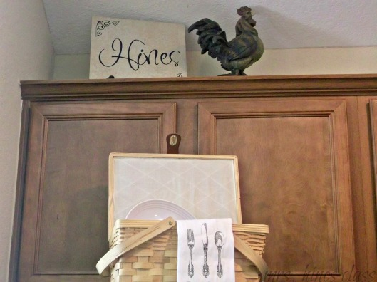 rooster, basket, tea towel, wood cabinets, kitchen, french country